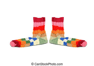 Warm knitted woolen socks knitting needles isolated on a white b