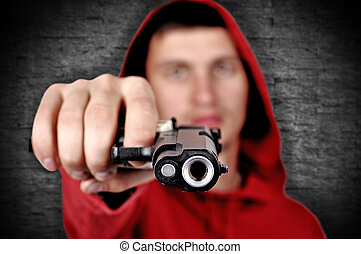 burglar with gun on a gray background