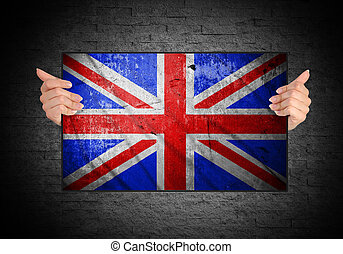 hand holding flag of United Kingdom