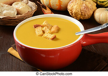 Butternut squash soup - A cup of butternut squash soup with...