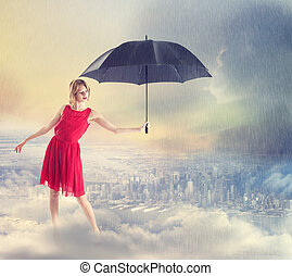 Woman Shielding the City from the Rain with Umbrella