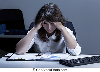 Office worker analyzing chart - Young office worker having...
