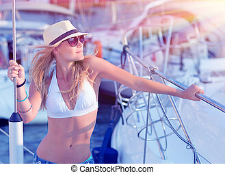 Attractive woman on sailboat
