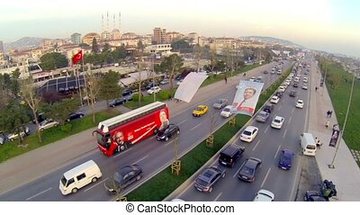Bus passes on streets in Istanbul - Fly over view9 Campaign...