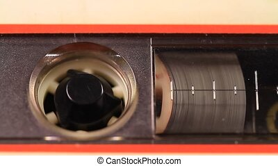 Tape in use sound recording - A macro static camera view of...
