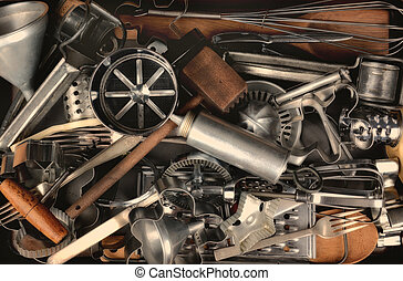 Old Kitchen Utensils - Closeup of a group of old metal and...