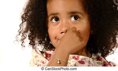 child with finger in her nose