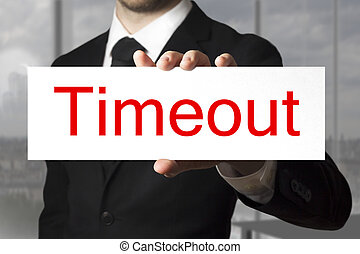 businessman holding sign timeout - businessman in blach suit...