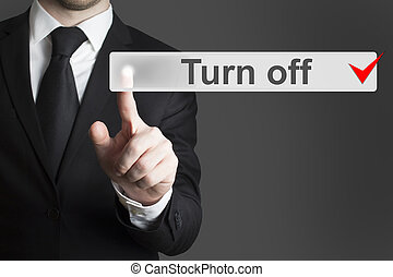businessman pushing flat button turn off - businessman in...