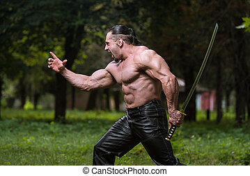 Strong Man With Samurai Sword - Action Hero Muscled Man...