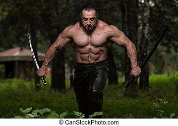 Fighter Holding Ancient Sword - Action Hero Muscled Man...