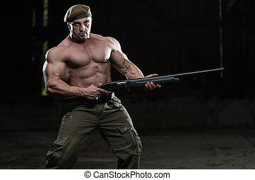 Soldier Aims Machine Gun - Action Hero Muscled Man Holding...