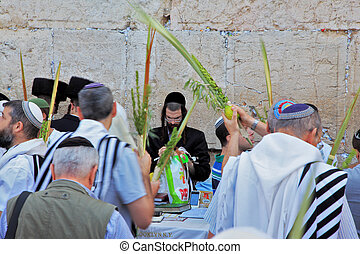 The religious Jews in traditional robes tallit - JERUSALEM,...