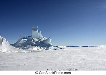 Icebergs on Antarctica - Iceberg frozen solid in the sea ice...