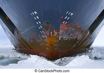 Hull of an icebreaker parked in the ice on Antarctica