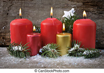candles for Chistmas Eve - red and gold candles in Christmas...