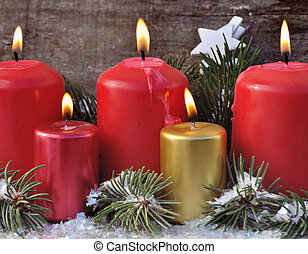 Christmas Eve - red and gold candles in Christmas decor on...