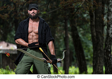 Man With A Bow And Arrows In Woods - Beard Man With A Bow...