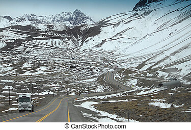 snow mountain road on the border of Argentina and Chile -...