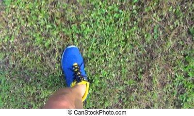 runner jogging on the grass in park