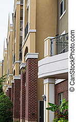 Stucco Balconies Over Brick Columns - Rows of modern stucco...