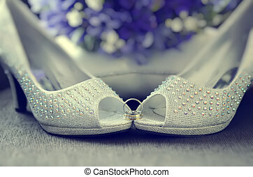 Beaded Bride Shoes - White beaded shoes of bride with...