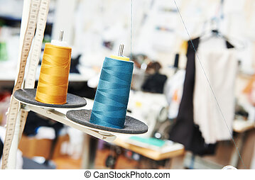 tailor sewing concept, reals of thread in workshop
