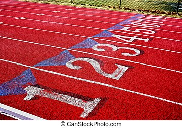 Numbered lanes. - Numbered lanes on a red running track.