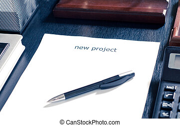sheet of paper on a table with the word new project Insert...