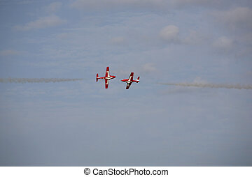airshow - two planes flying very close toward each other