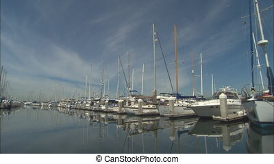AlamedaMarina_WSboatwaymov - WS of a boats berthed along one...