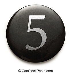 White number 5 on black badge - White number 5 on black...