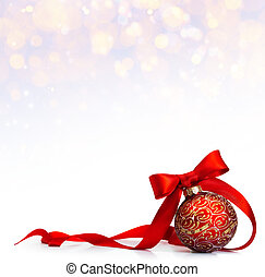 art Red Christmas ball on a glossy surface
