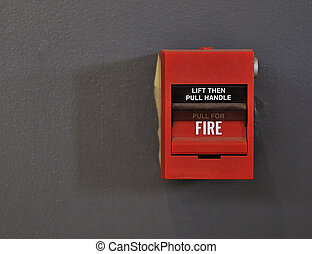 Fire Alarm - Close-up shot of a red fire alarm against a...
