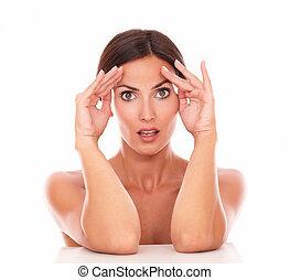 Beautiful hispanic woman touching her face