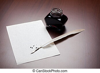 Quill, ink and paper - Ink, quill and an empty, splodged...