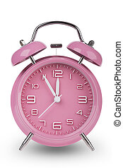 Pink alarm clock with hands at 5 minutes till 12 - Pink...