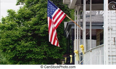 AmericanFlagOnPorch - MS of an American flag displayed...