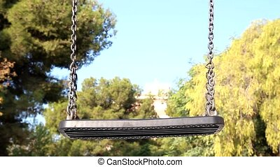 Playground Swing - Empty Playground Swing in a Park