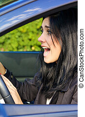 Woman in car screaming getting into accident - Young woman...