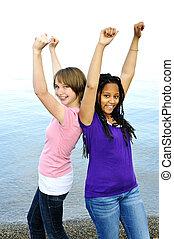 Happy girlfriends - Portrait of two teenage girl friends...