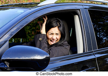 Woman in car shouting because of accident