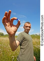 World in your hands - Guy holding small earth globe - the...