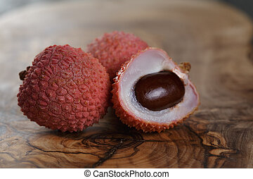 ripe lychee fruits, on olive wood table
