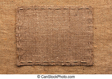 Frame of burlap, lies on a background of burlap, with place...