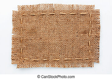 Frame of burlap, lies on a background of burlap with place...