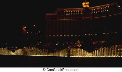 BellagioFountainDisplay2 - LS of the Bellagio hotel and...
