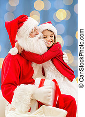 smiling little girl with santa claus - holidays, christmas,...
