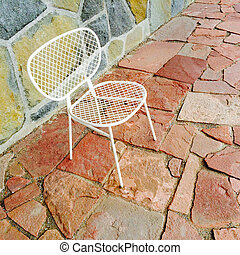 White chair on bright tile background