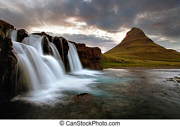 Waterfall with volcano in Iceland